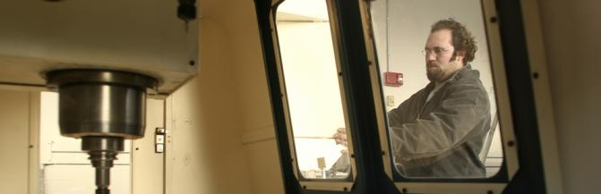 Professor looking at equipment